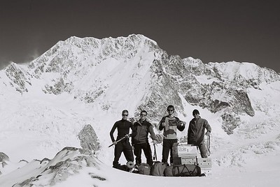 International Scree Expedition. Carl Armfelt- Communications Officer (left), James Wake- Brewing Engineer, Phillip Toms- Flag Bearer, and Trent Williams- Helicopter Liason Officer. This was taken directly after landing at Plateau Hut. The boxes contain our 11 days worth of food, coke and beer. Mt Cook's Middle and High peaks in the background. Taken by Carl. 24 Mar 04