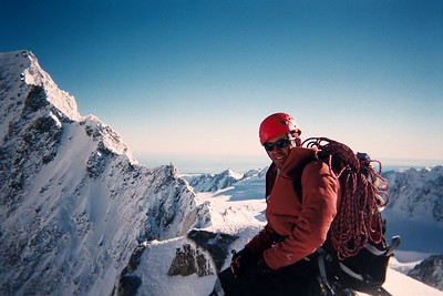 Trent on top of Mt Dixon with Mt Haast in the background. Taken after climbing the West Face, Central Gully. 29 Mar 04