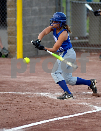 -Messenger photo by Britt Kudla<br />  Renee Maneman of Newell-Fonda connects for a single down the third base line against St. Edmond on Monday
