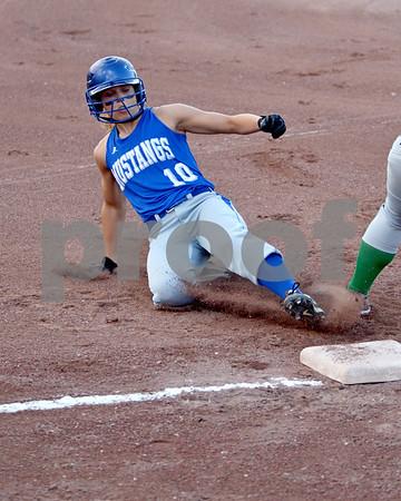 -Messenger photo by Britt Kudla<br />  Renee Maneman of Newell-Fonda steals third during the first inning against St. Edmond on Monday at Roger Park