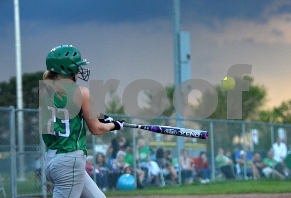 -Messenger photo by Britt Kudla<br /> Amanda Lansman of St. Edmond connects for a home run during the first inning against Newell-Fonda on Monday at Roger Park