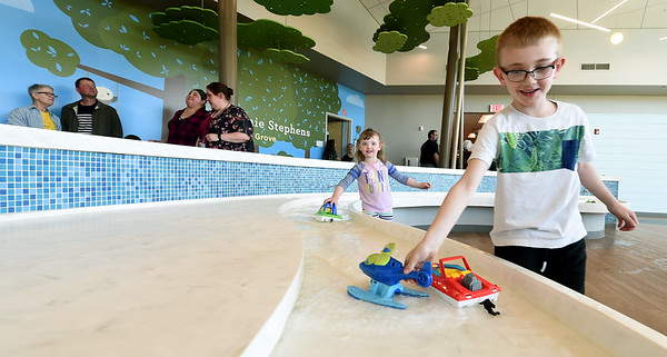 Bentley Allphin, 6 and his sister, Anslee Allphin, 4, check out the water feature that also serves as a handwashing sink in the Stephanie Stephens Learning Grove inside the Joplin Early Childhood center on Thursday.<br /> Globe | Laurie Sisk