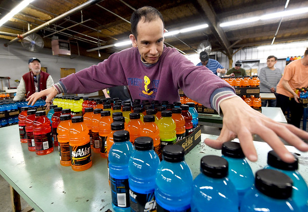 Mark Ardelean packages sports drinks on Wednesdayat Joplin Workshops, Inc. Ardelean was one of about 50 employees at the workshop who was laid off after a fire in the laundry facility at the workshop. Ardelean has since returned to the workshop as it picked up new projects.<br /> Globe | Laurie Sisk