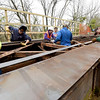 Joplin Trails Coalition volunteers and students and staff of the Pittsburg State University Construction Department work to shore up a bridge on Ruby Jack Trail on Saturday.<br /> Globe | Laurie Sisk