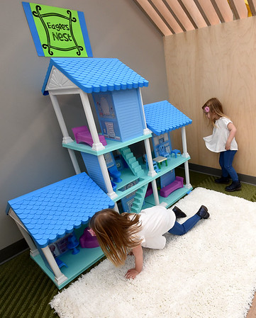 From the left: three-year-old twins Ella and Emma Hensley check out one of numerous activity nooks inside the new  Joplin Early Childhood center on Thursday.<br /> Globe | Laurie Sisk
