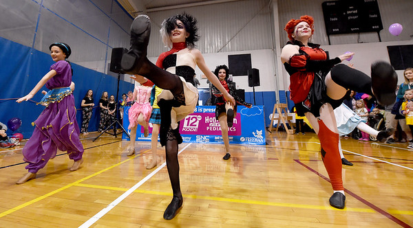Junior dancers from the Midwest Regional Ballet entertain guests with a Disney-themed performance at the Joplin Family YMCA's Heatlhy Kids Day on Saturday at the YMCA.<br /> Globe   Laurie Sisk