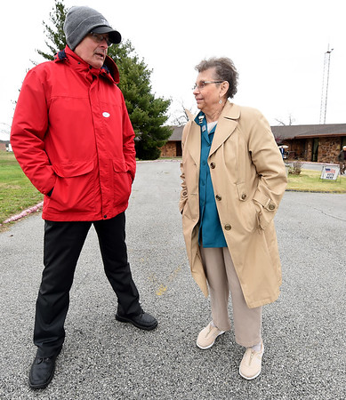 Incumbent City Councilman for Zone 4 Morris Glaze posts himself outside the polls to talk to voters as he chats with Sharon Minton on Tuesday at Calvary Baptist Church. Glaze expressed disappointment at the low turnout in Tuesday's elections.
