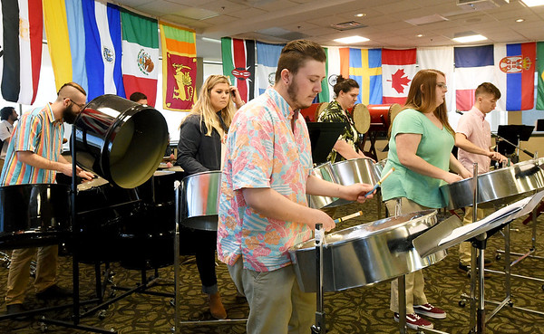 Members of the Missouri Southern World Percussion Ensemble entertain guests with Carribean style music on Saturday night at the World Music and Cuisine Festival at MSSU. The event featured food and music from a host of nations. MSSU international students, faculty and staff, along with community members provided the food for the annual event.<br /> Globe | Laurie Sisk