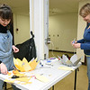 From the left: Jacey Vangel and Suzanne Bowling create paper flower decorations on Saturday at Empire Market.<br /> Globe | Laurie Sisk