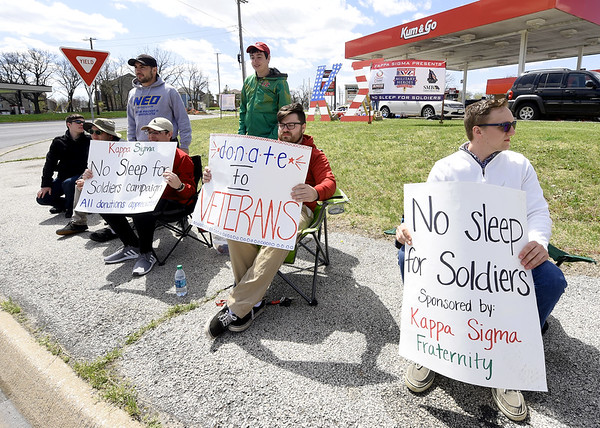 Members of Missouri Southern's Kappa Sigma fraternity solicit donations for their annual No Sleep for Soldiers campaign on Wednesday at 7th and Duquesne. Last year the group raised $5,200 in the campaign, which benefits various military and veteran causes each year.<br /> Globe | Laurie Sisk