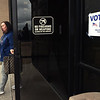 Shawn Fowler exits the Donald E. Clark Justice Center after casting her vote on Tuesday during a low turnout election.<br /> Globe | Laurie Sisk