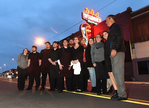 The staff and management of Wilder's stand outside near their newly remodeled neon on Saturday night.<br /> Globee | Laurie Sisk