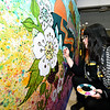 Carthage artist Martha Goldman creates a portable mural representing local flora and fauna on Saturday in preparation of the opening of the Empire Market.<br /> Globe | Laurie Sisk