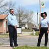 From the left: Scott Clayton and Melodee Colbert-Kean stand near one of 12 banners currently hanging in East Town.<br /> Globe | Laurie Sisk