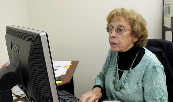 NALA Executive Director Marj Boudreaux works from her desk on Thursday at NALA. Boudreaux is retiring in June after 24 years of service.<br /> Globe | Laurie Sisk