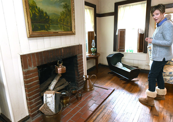 Anne Patterson Doyle stands next to one of the original fireplaces inside her Civl War era home. Patterson Doyle grew up next door to the house that once served as a Civil War hosptal and command post and eventually purchased the historic property.<br /> Globe   Laurie Sisk