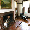 Anne Patterson Doyle stands next to one of the original fireplaces inside her Civl War era home. Patterson Doyle grew up next door to the house that once served as a Civil War hosptal and command post and eventually purchased the historic property.<br /> Globe | Laurie Sisk