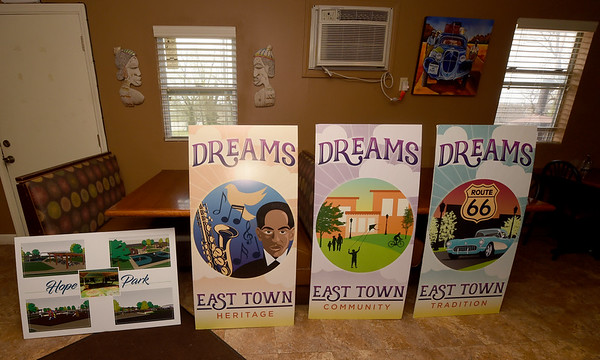 Prototypes of banners containing the themes of heritage, community and tradition stand alongside a vision for Hope Park on Tuesday at Me's Place.<br /> Globe   Laurie Sisk