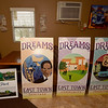 Prototypes of banners containing the themes of heritage, community and tradition stand alongside a vision for Hope Park on Tuesday at Me's Place.<br /> Globe | Laurie Sisk