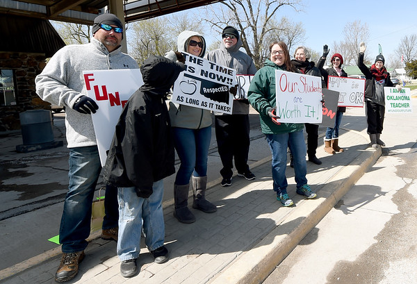 Quapaw teachers gather in downtown Quapaw on Saturday to protest for better school funding and pay. The group plans to travel to Oklahoma City on Monday, when they will join a statewide protest at the Capitol.<br /> Globe   Laurie Sisk