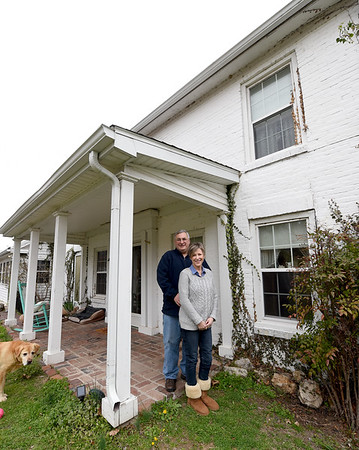 Newlyweds Jim Doyle and Anne Patterson Doyle and their dog Holly stand outside the Civl War era home that Patterson Doyle purchased after a lifetime of envying the historic home. Patterson Doyle grew up next door to the house that once served as a Civil War hosptal and command post.<br /> Globe   Laurie Sisk