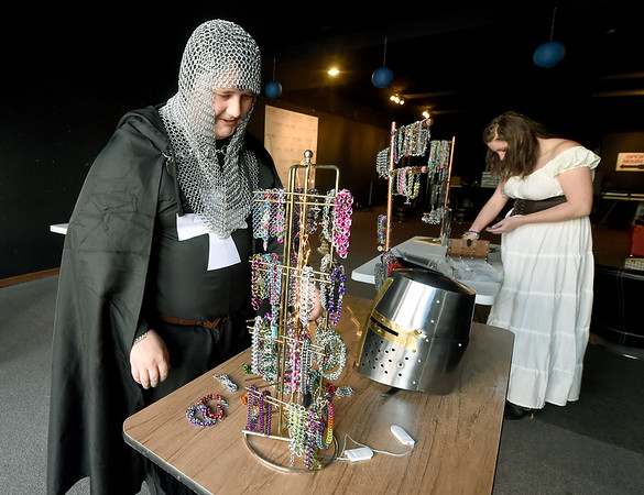 From the left: Tyler and Machell Maille set up their handmade jewelry booth during Third Thursday in downtown Joplin. The duo comprise Princess Maille and design jewlery using the same metal weaving methods deployed in Medieval times.<br /> Globe   Laurie Sisk