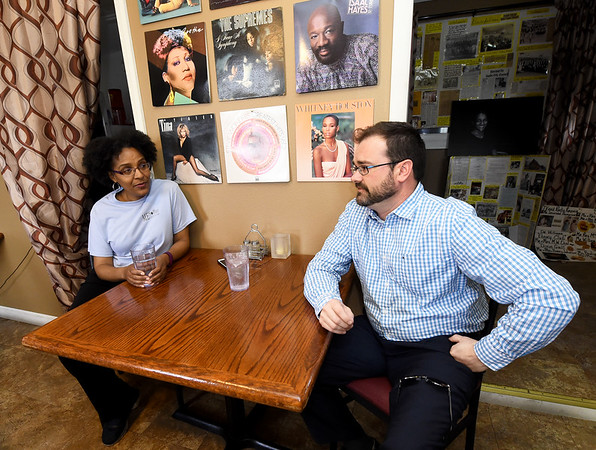 From the left: Melodee Colbert-Kean and Scott Clayton share their ideas for the community of East Town on Tuesday at Me's Place.<br /> Globe   Laurie SIsk