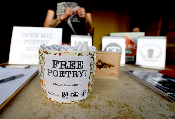 Small literary treasures await guests at a free poetry reading as part of National Poetry Month sponsored by Connect2Culture, the Post Art Library and Pub Hound Press on Thursday night at Empire Market.<br /> Globe   Laurie Sisk