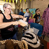 Penny Moore, of Wellspring Acres Alpaca Farm in Sarcoxie, hand cards Alpaca wool on Saturday during the opening of the Empire Market as crowds flood the market to check out a variety of vendors.<br /> Globe | Laurie Sisk