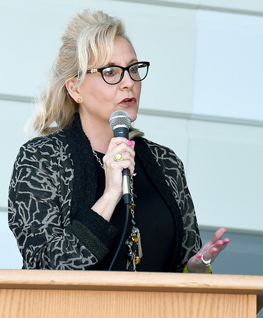 Joplin Early Childhood Education Director Amanda Boyer addresses guests at the ribbon cutting ceremonies for the new Joplin Early Childhood center on Thursday at the JEC.<br /> Globe | Laurie Sisk