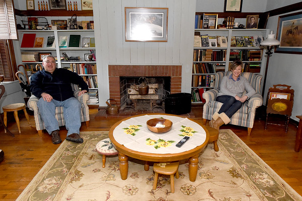 Newlyweds Jim Doyle and Anne Patterson Doyle sit in the library of the Civl War era home that Patterson Doyle purchased after a lifetime of envying the historic home. Patterson Doyle grew up next door to the house that once served as a Civil War hosptal and command post.<br /> Globe | Laurie Sisk