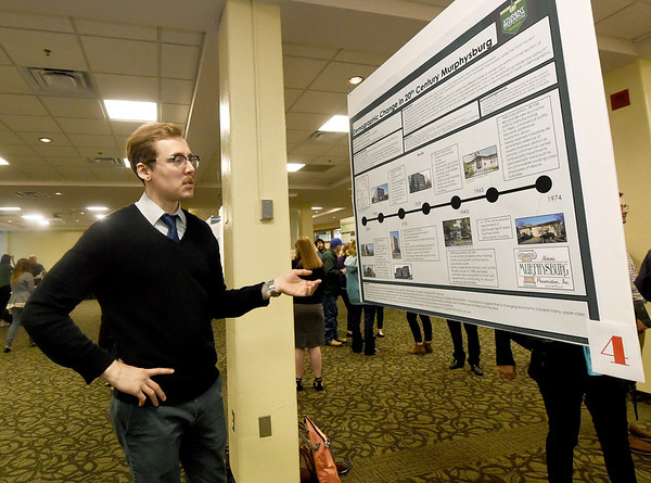 Missouri Southern Sociology major Garrett Pekarek talks about his research into the changing demographics in the Murhysburg neighborhood from the 1890s to 1974 during the MSSU Research Symposium on Wednesday afternoon at MSSU. Thirty projects from six disciplines, from humanities to the physical and biological sciences were on display, with first and second place awards presented in each discipline.<br /> Globe | Laurie SIsk