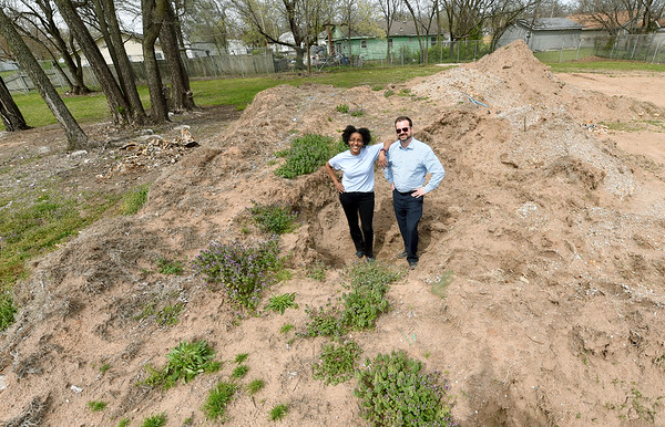 From the left: Melodee Colbert-Kean and Scott Clayton stand in dirt that will eventually be Hope Park, just north of Joe Becker Stadium.<br /> Globe | Laurie SIsk