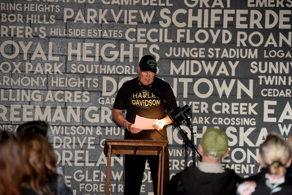 """Duane Henry Hoefer Lyon reads his poem, """"As I Plow,"""" during a free poetry reading as part of National Poetry Month sponsored by Connect2Culture, the Post Art Library and Pub Hound Press on Thursday night at Empire Market.<br /> Globe 