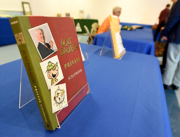 A biography of reknowned cartoonist Mort Walker sits on a table as it becomes part of several books about Walker's work to be included in the Crowder College Library.<br /> Globe | Laurie Sisk
