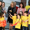 Flanked by Joplin's littlest Eagles, Early Childhood Education Director Amanda Boyer cuts the ribbon for the new Joplin Early Childhood center on Thursday at the JEC.<br /> Globe | Laurie Sisk