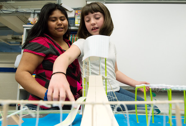 Globe/Roger Nomer<br /> Ashley Lopez, left, and Jade Logsdon, Carthage fifth graders, talk about their team's design for the new playground at Carthage Intermediate School on Friday.