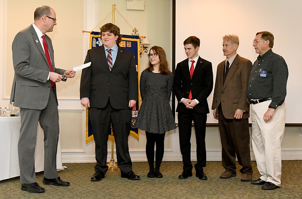 """From the left: Kiwanis President Mark Johnson presents a $500 check to Joplin High School Constitution Team members Donald Archer, Anna Iorio and Braden Drake as team coach William Keczkemethy and Kiwanis member Larry Myers look on Tuesday at Twin Hills. The funds will be used to help with expenses to the national """"We the People"""" constitution team competition in Washington, D.C. in late April. About $1,700 per student is needed to finance the trip. Donations may be mailed to Joplin High School in care of the constitution team.<br /> Globe 