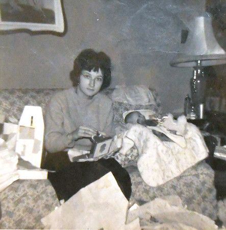 Jana Smith's grandmother, Rachel Sidenstricker sits with Smith's mother, newborn Rhonda Sidenstricker in this family photo. Sidenstricker died before Jana was born and Rhonda passed away when Jana was 16. Smith's photo albums are one of her most important connections to her family.<br /> Globe | Laurie Sisk