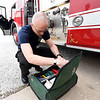 Goodman Area Fire Protection District volunteer Jared Mackall checks the contents of a first aid kit on Thursday at the department's leased space in Goodman.<br /> Globe | Laurie Sisk