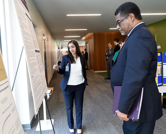 Kansas City University student doctor Mira Abdel-Sattar, left discusses her research related to the the separation of a viable and a non-viable twin in utero with KCU professor Marcus Iszard during the 26th Annual Kansas City University Research Symposium on Wednesday at KCU. <br /> Globe | Laurie SIsk