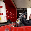 Goodman Area Fire Protection District volunteer Derek Parsons loads a tank onto a truck on Thursday at the department's leased space in Goodman.<br /> Globe | Laurie Sisk