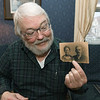 Murphysburg resident Jim Scott holds a vintage photograph of Mildred Millisa Wilson Taylor and her husband, Lee Taylor - the first elected mayor in the City of Joplin.<br /> Globe | Laurie SIsk