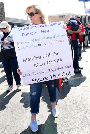 Retired Carl Junction educator Lori Good, who hails from a family of teachers, lobbies for increased dialogue on how to make schools safe during a March for Our Lives rally on Main Street on Saturday.<br /> Globe | Laurie Sisk