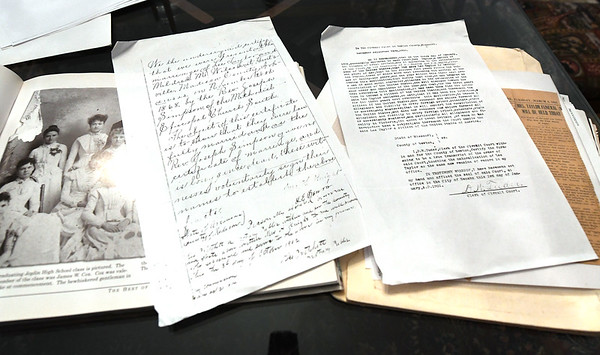 Documents and photographs regarding Mildred Millisa Wilson Taylor sit on a table in the Murphysburg home of Jim Scott on Tuesday.<br /> Globe | Laurie SIsk