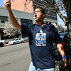 Nate Stroud, of the Green Alliance of Southwest Missouri , leads chants as he videotapes the March for Our Lives rally on Saturday in downtown Joplin.<br /> Globe | Laurie SIsk