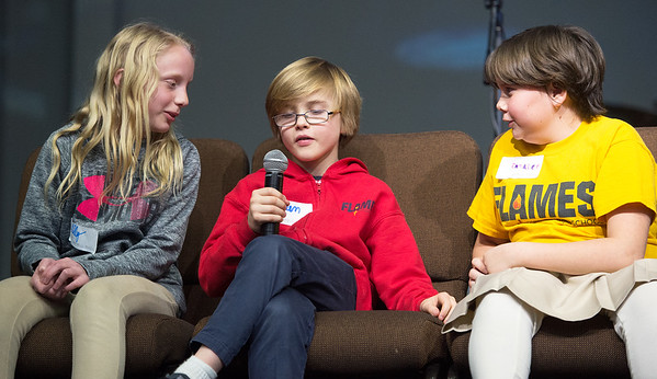 """From the left: Martin Luther fourth graders Lilly Plassman, Laken Murdock and Emmalee Bright team up to spell """"equator"""" during the 19th Annual NALA Spell Ball on Tuesday night at St. Paul's United Methodist Church. The 14-team event also featured a silent auction, baseball-inspired concessions and more. <br /> Globe   Laurie Sisk"""