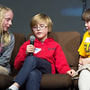 """From the left: Martin Luther fourth graders Lilly Plassman, Laken Murdock and Emmalee Bright team up to spell """"equator"""" during the 19th Annual NALA Spell Ball on Tuesday night at St. Paul's United Methodist Church. The 14-team event also featured a silent auction, baseball-inspired concessions and more. <br /> Globe 