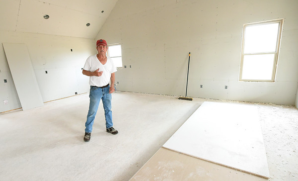 Gary Willman stands inside the living room of the new home he and his wife hope to inhabit soon. Willman's home of 44 years was destroyed in last year's tornado in Goodman.<br /> Globe | Laurie Sisk