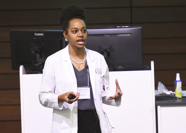 Kansas City University student doctor Taelah Wooten presents the finings of her research to colleagues during the 26th Annual Kansas City University Research Symposium on Wednesday at KCU. <br /> Globe | Laurie SIsk